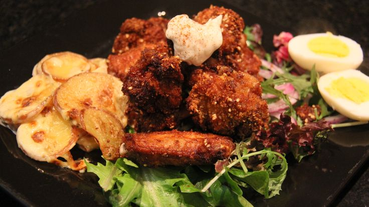 Deep Fried Chicken Nibble Shanks with Chicken Flavored Scolloped Potato's on Salad
