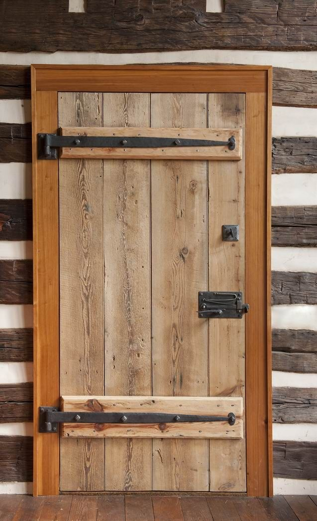 The hardware for the main door is made locally. The door latch, with its simple exposed latching mechanism, sets the entry apart.