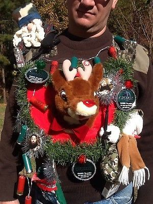 REDNECK Ugly Christmas Sweater-Santa has a cigarette in his mouth, a beer in one hand and a rifle in the other.Rudolph was hunted down & mounted but he still plays his favorite tune if you press his antler (his rear sticks out the back). A happy hunter snowman has a rifle and there is a little bear in a cigarette box drinking moonshine. A string of shotgun shell lights with a battery case that fits in a Nascar stocking. With ornaments:Grizzly Chewing Tobacco tops and Duck Dynasty Men.