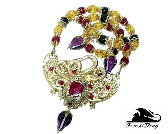 Golden necklace and earrings Red sea ruby buds