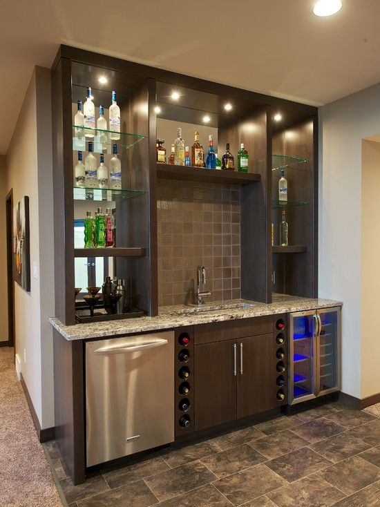 Basement Bar.  I love the idea of the mirror behind the bottles.  Looks really cool.