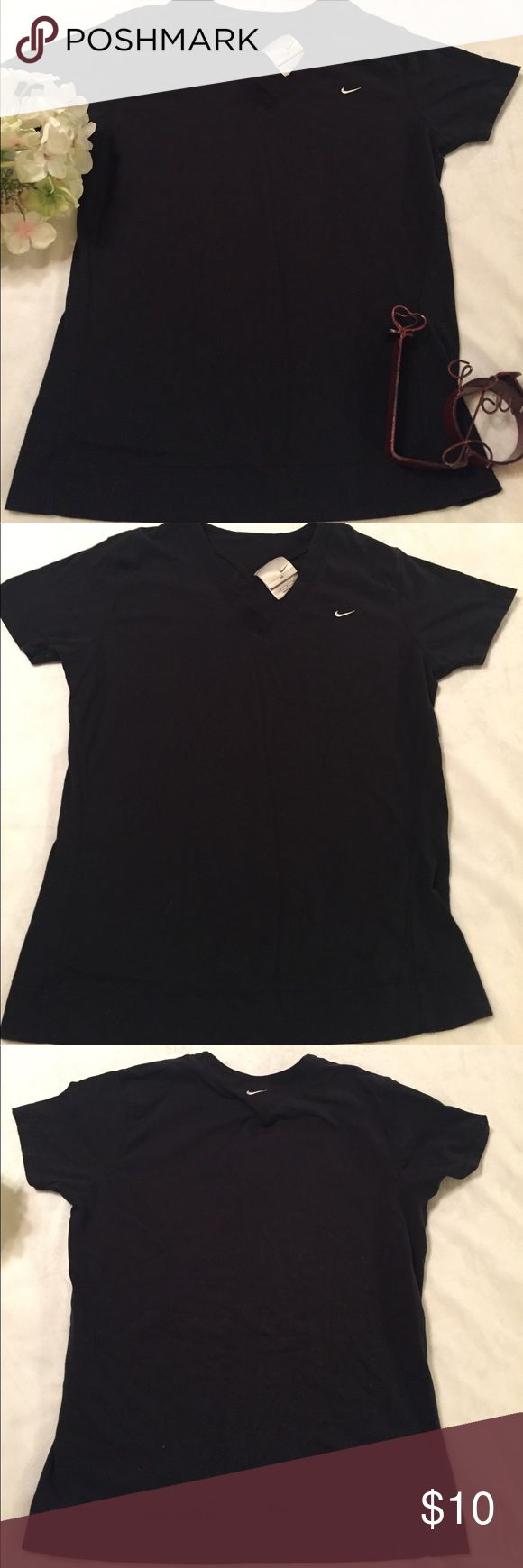 Nike workout shirt This shirt is like new, black Nike workout shirt; 95% cotton, 5% spandex Nike Tops Tees - Short Sleeve