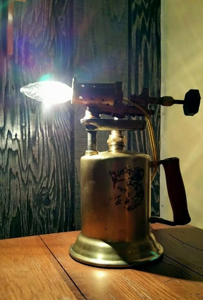 One of my Torch Lamps, made from an antique torch. Can be purchased at Old Towne…