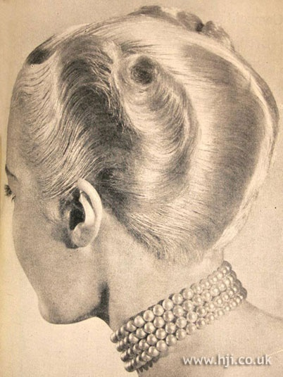 1950 waves crop hairstyle    Hair was brushed away from the face, smooth at the front with curls at the ends     Hairstyle by: Henry da Costa