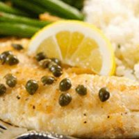 Striped Bass with Brown Butter, Capers, and Lemon by anonymous Ingredients: 1 cup flour 1 tablespoon black pepper 1 tablespoon white pepper 1 tablespoon cayenne pepper 2 tablespoons kosher salt 4 eight-ounce striped bass fillets 6 tablespoons butter, divided 1/4 cup caperberries Juice of 1 lemon, plus additional lemon slices for garnish 1/2 cup white …