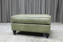 Ottoman with cushion top and turned legs in pure aniline leather