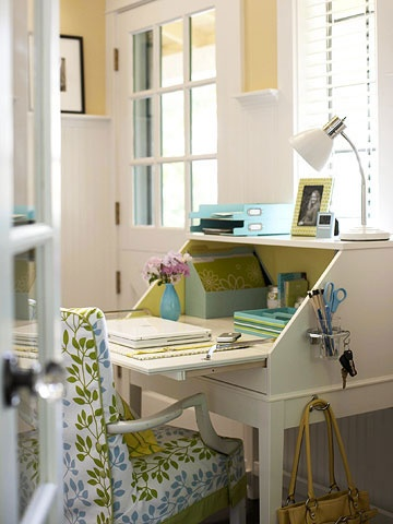 """""""Attach an inexpensive toothbrush-and-tumbler holder to the side of the desk to stash pens, pencils, and a pair of scissors. Hang S hooks for keys."""""""