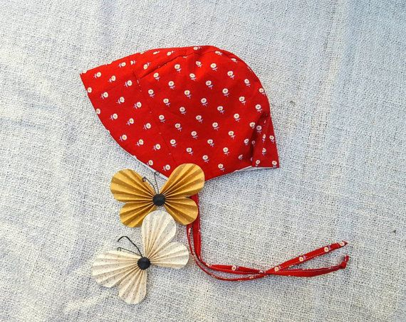Cute flowers on red background. Modern baby bonnets by Marlini Boutique