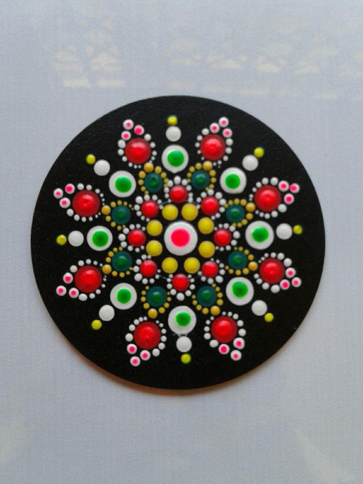 Mandala painted on a CD
