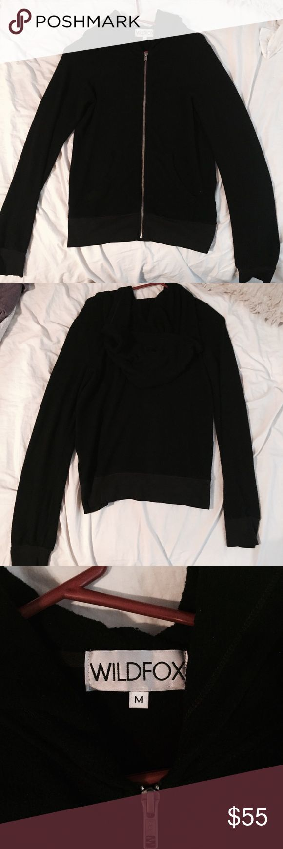 Wildfox black essential malibu zip up hoodie In great condition does gave pilling but thats what wildfox is known for other than that no flaws! Silver zipper. Size medium but very roomy. Feel free to ask any questions. Wildfox Tops Sweatshirts & Hoodies