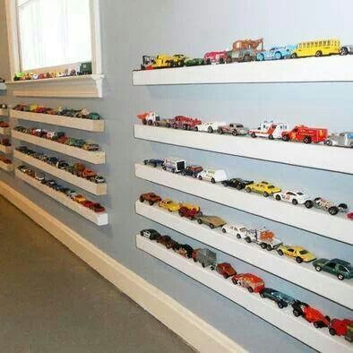 Awesome way to store all their toy cars! 2x2 painted white with magnetic paint on top.