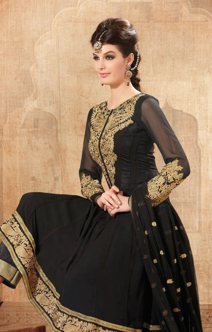 Black color georgette kameez, york decorated with heavy gold color resham embroidered aplic cut work patch and sleeve also along with lase patch border.  As shown suit can be made available and also can be customized as per your style subject to fabric limitation.Unstitched kameez can be customize upto 40 inches. Salwar Kameez with Chiffon Dopatta and Satoon bottom. Approximate kameez length approx 46 TO 48 inches.s