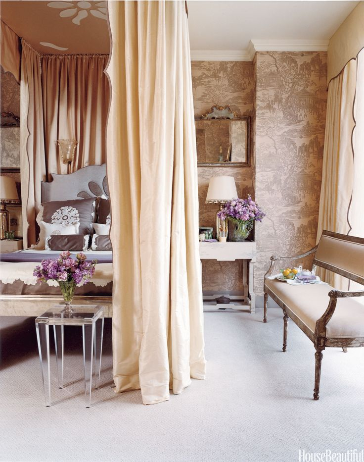 """""""I wanted it to be feminine and cocooning,"""" says designer Celerie Kemble. """"It's all creams and soft grays and a color that just smells like cantaloupe but is probably closer to apricot. The sheers at the windows diffuse the light, so the effect is all soft and dreamy like the old way they used to shoot movie stars — with Vaseline on the camera lens.""""   - HouseBeautiful.com"""