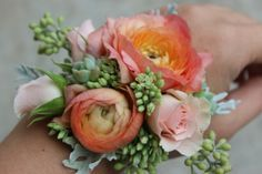Prom Glam-Peach coral ranunculus wrist corsage with succulents