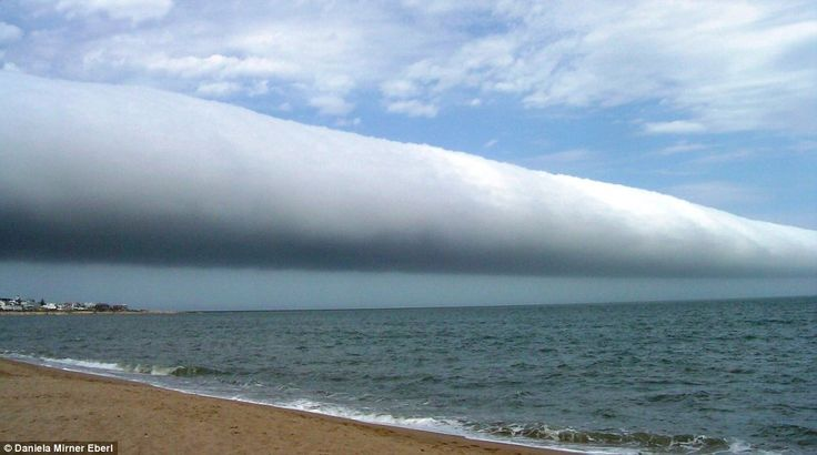 Astronomers Robert Nemiroff and Jerry Bonnell, said: 'These rare long clouds may form near advancing cold fronts.   'In particular, a downdraft from an advancing storm front can cause moist warm air to rise, cool below its dew point, and so form a cloud.  'When this happens uniformly along an extended front, a roll cloud may form. via Claire Bates, dailymail.co.uk #Roll_Cloud #NASA #dailymail  'Roll clouds may actually have air circulating along the long horizontal axis of the cloud.'