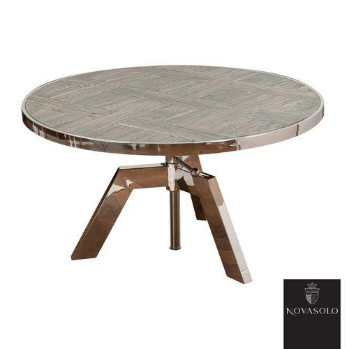Råtøft Frost sofabord med justerbar høyde. Bordet er produsert i en kombinasjon av resirkulert, gråvasket alm og blankpolert rustfri stål!Treverket er resirkulert som betyr at kvister, sprekker, skjevheter og andre mindre defekter er en bevisst og naturlig del av produktet - hvert enkelt møbel vil være helt unikt og ha sin egen sjarm! Fargevariasjoner vil forekomme innad på hvert møbel og fra produkt til produkt.Mål:Diameter 80 cmHøyde 44-62 cmMaterialer:Resirkulert, gråva...