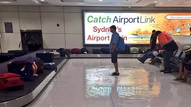 Flooding at Sydney Airport kept passengers on their toes last night. Picture: Supplied