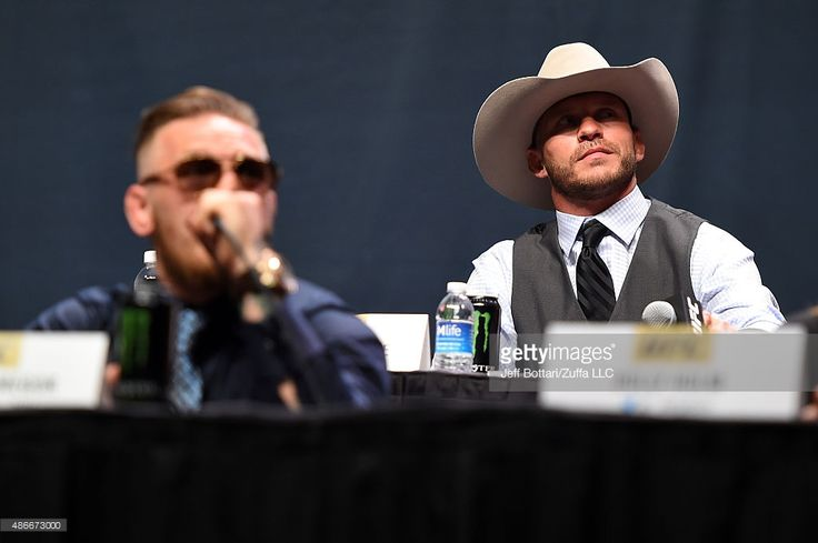 UFC lightweight title challenger Donald 'Cowboy' Cerrone exchanges words with UFC interim featherweight champion Conor McGregor during the UFC's Go Big launch event inside MGM Grand Garden Arena on September 4, 2015 in Las Vegas, Nevada.