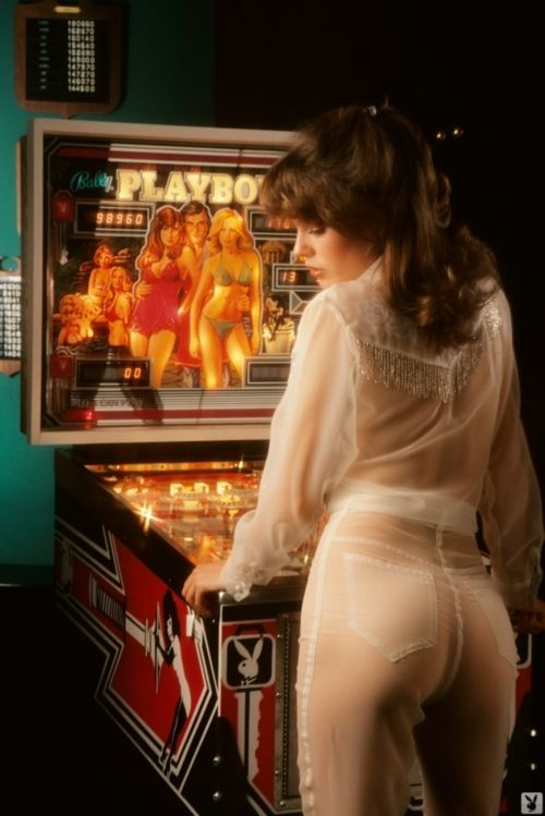 Playmate Candy Loving plays Playboy pinball, 1970s. I played this machine more times than I can count...