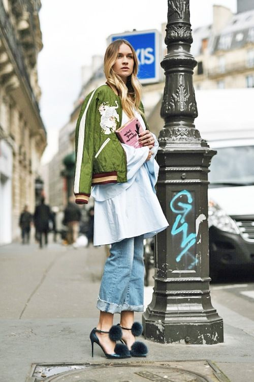 This green embroidered Chloe bomber jacket looks great with a flared sleeve blue shirt dress, boyfriend jeans heeled sandals with furry pom-poms.