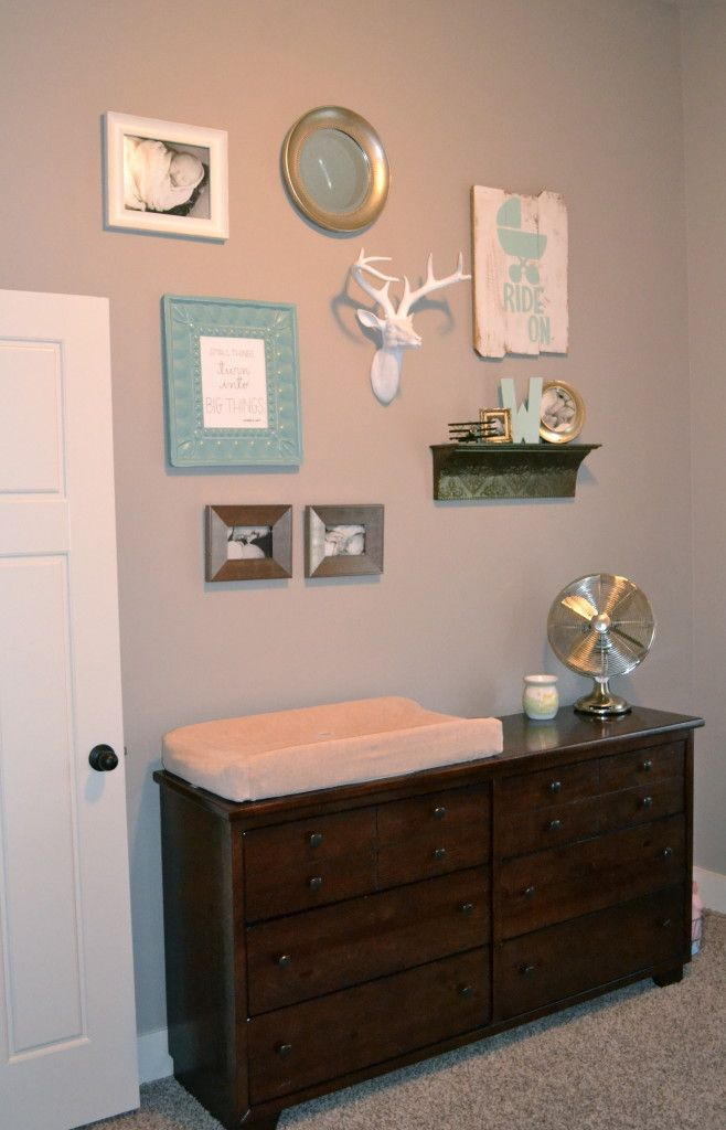 This gallery wall adds a masculine touch to this baby boy nursery. Maybe would replace the deer though