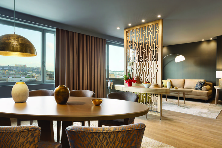 One of the best choices of accommodation at #Wyndham #Grand #Athens, our majestic #Presidential #Suite. A massive, crystal-clear window offers guests staying here an absolutely spectacular view of the whole city!