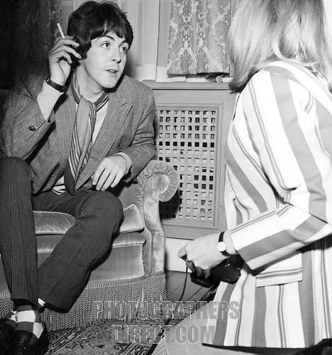 Paul McCartney of The Beatles smokes a cigarette whilst being interviewed by photographer Linda Eastman ( his future wife ) . London , 12 January 1967 . stock photo