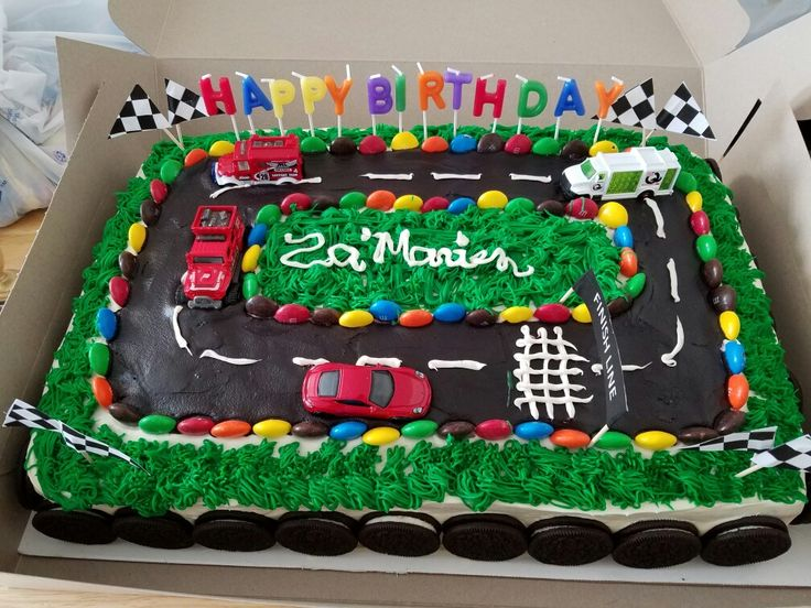 Race car cake made by me! My God son seen and idea and we went for it. It's a very easy cake to make it does take time. Enjoy!!