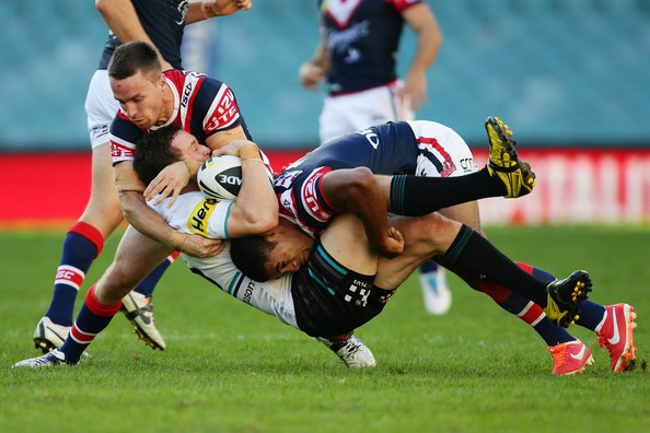 David Simmons of the Panthers is tackled during the round eight NRL match between the Sydney Roosters and the Penrith Panthers at Allianz Stadium on May 5, 2013 in Sydney, Australia.