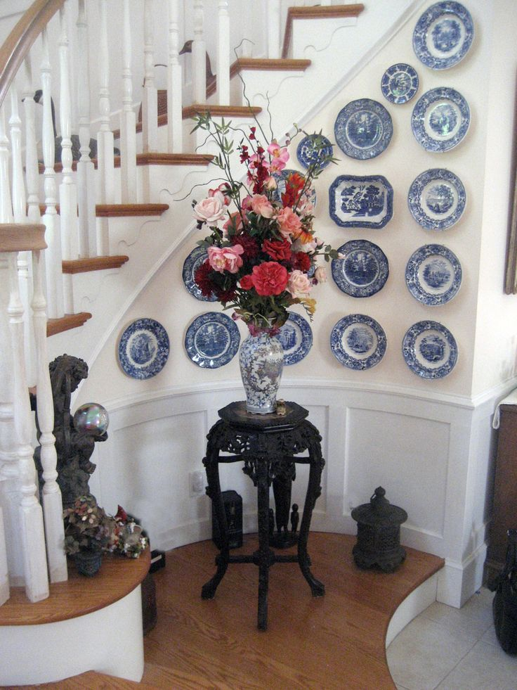 Antique Blue transferware in Foyer making  an unusual and dramatic foyer statement.
