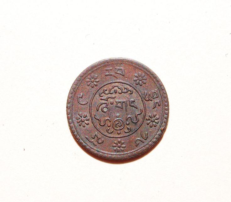 2b. Reverse side of a Tibetan 20th century cash coin.