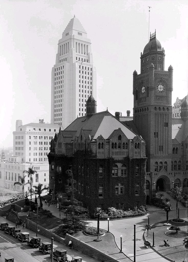 The old Los Angeles County Courthouse, with City Hall in the background, late 1920's. The Courthouse - seriously damaged in the Long Beach Earthquake of '33 - was demolished in 1936.