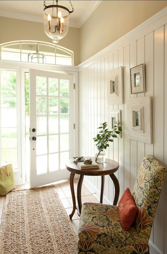 Pretty minimalist entrance hall - like the covered chair with the pillow