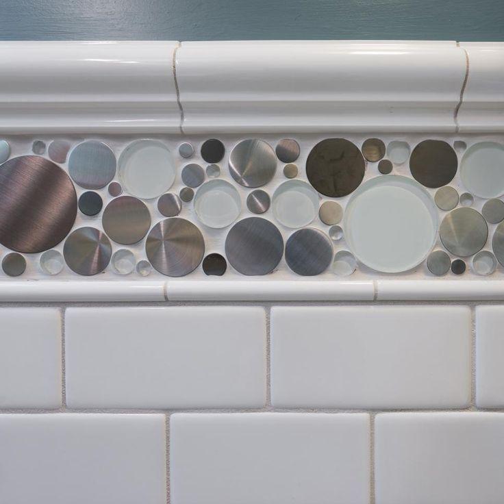 Jazz up classic white subway tile with an accent tile like the steel