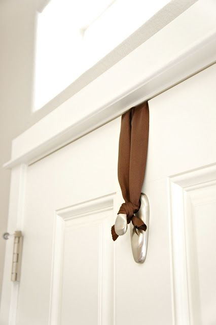 How to hang a wreath or other door decoration. Use a Command hook upside down on the inside of the door and wrap around it.