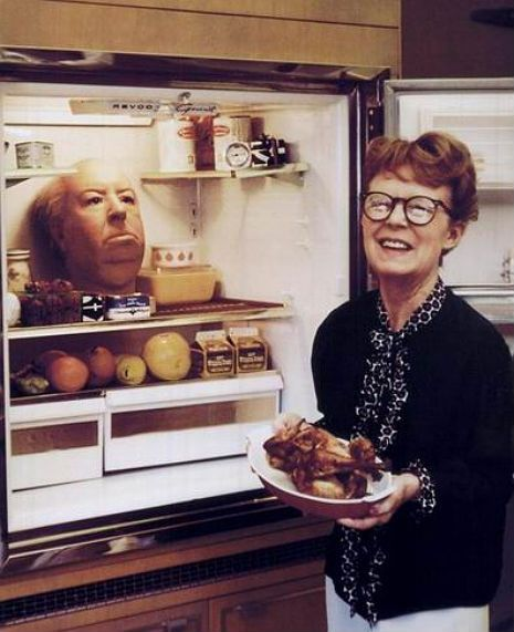 Alfred Hitchcock's wife, Alma Reville, poses lovingly with a refrigerated prop head of her dear husband. Photo by by Philippe Halsman.