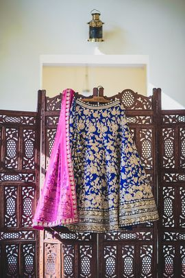 Bridal Lehenga - Blue and Gold Lehenga | WedMeGood Blue and Gold Silk Lehenga with gold zari floral embroidery, and bright pink net dupatta with zardosi border. Find more bridal lehengas on wedmegood.com #wedmegood #bridal #lehenga