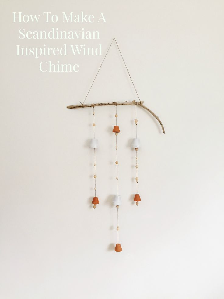 Learn how to make a minimalist, Scandinavian wind chime with all natural materials.