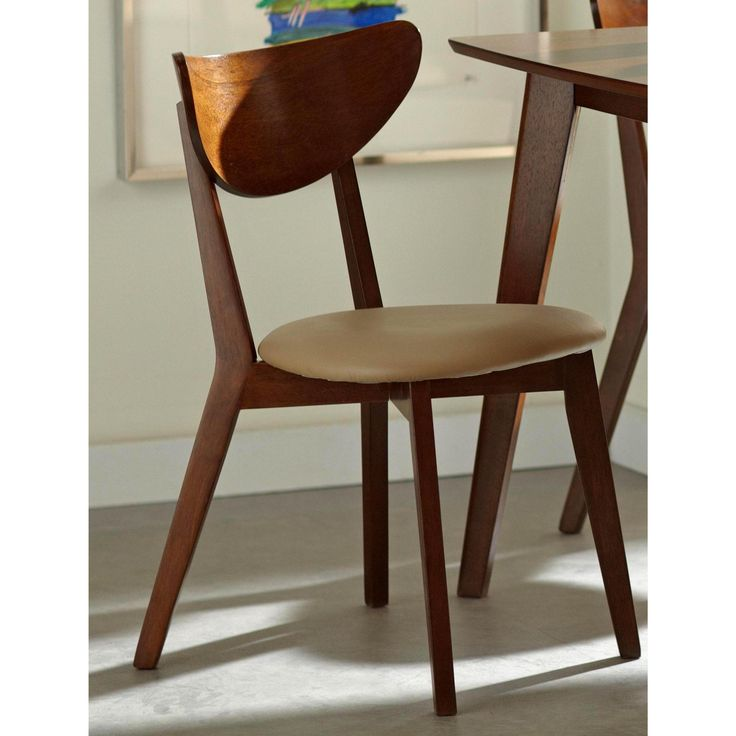 Bring retro design to your dining area with this set of for Modern dining chairs pinterest