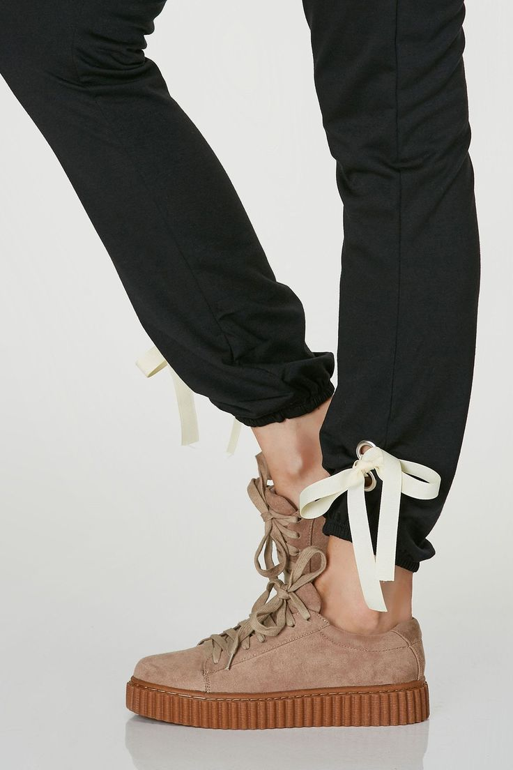 High rise sweatpants with relaxed fit and elasticized hem. Ribben accents at bottom for added detail. Comes in a set with matching top sold separately.
