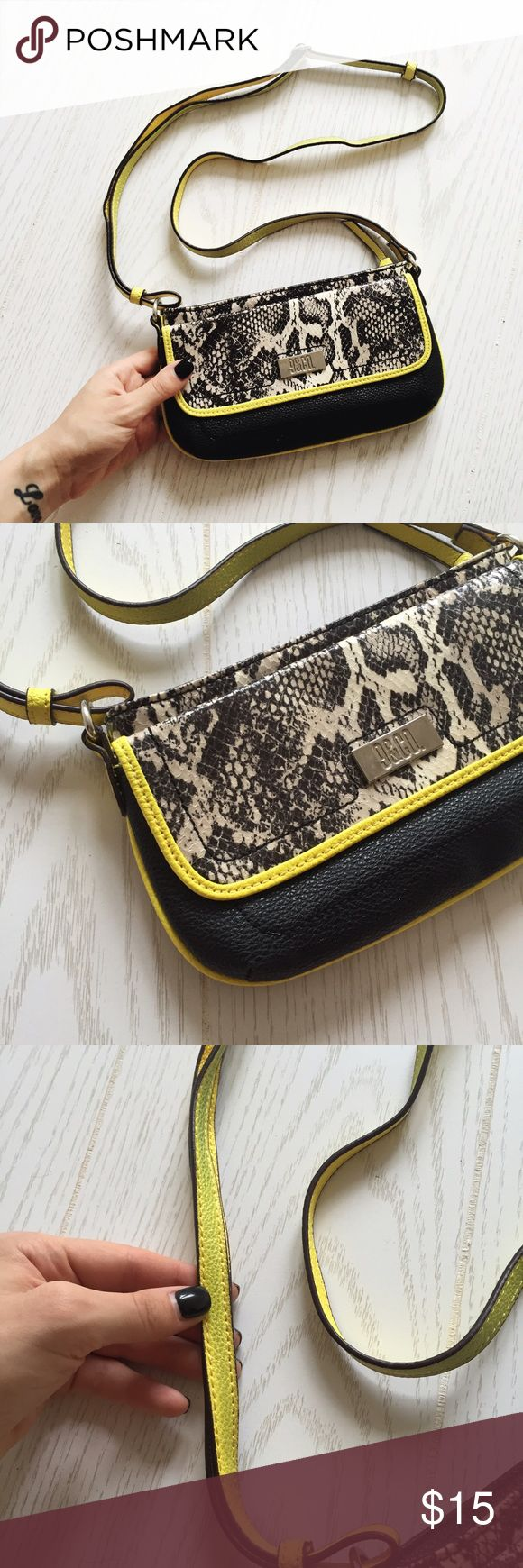 neon yellow, black, & snake skin crossbody purse neon yellow, black, & snake skin crossbody purse. perfect for a night out. only worn a couple of times. some dye transfer on the inside of the strap. can't be seen when wearing. so cute! jcpenney Bags Crossbody Bags
