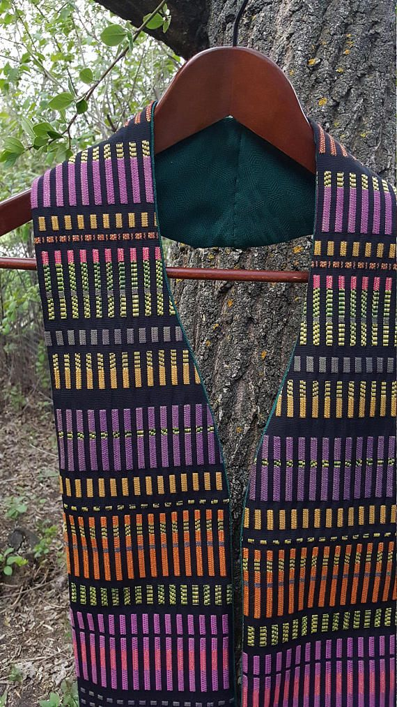 This multi-color African stole is reversible, with solid forest green on the back. It is perfect for ordinary time, lent or advent.  It is approximately 5 1/2 inches wide and 52 inches long. The curve of the neck makes it sit well and stay in place. It is medium-weight and comfortable.  This stole is made of upcycled fabric was purchased at a Christian thrift store that supports peace and development work. It comes in a reusable, upcycled cloth gift bag/carrying bag. It would make a...