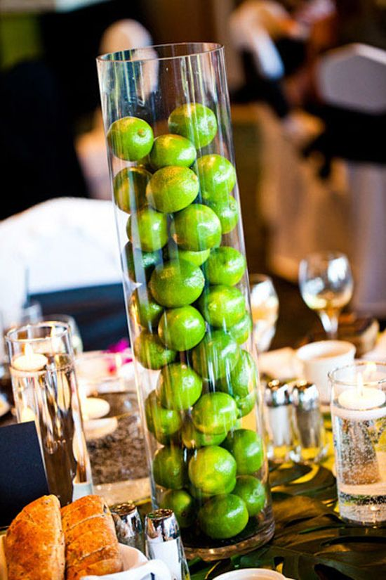 limes in glass cylinder on signature drink (mojito) table