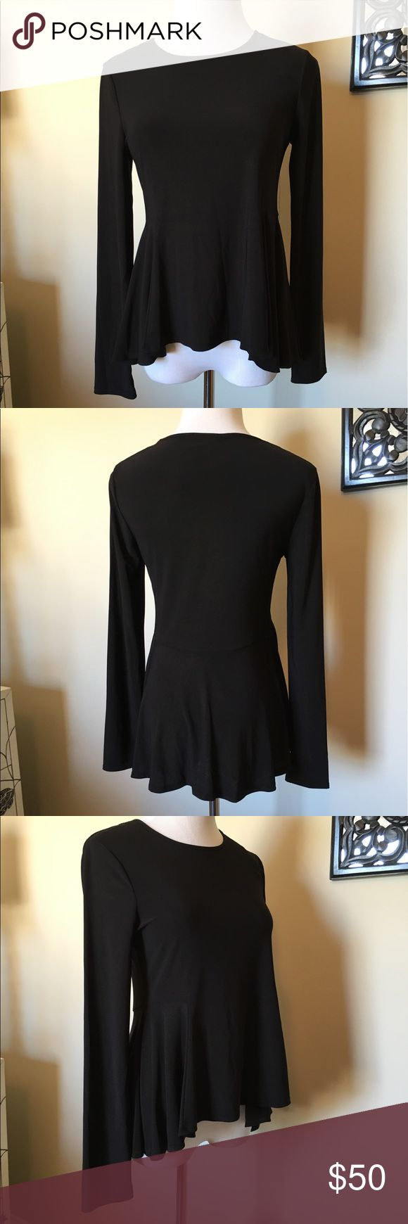 NWOT, CeCe, Stunning Black Long-sleeve Peplum Top! NWOT, CeCe, Stunning Black Long-sleeve Peplum Top! Amazingly quality with a great fit! Made of 96% polyester & 4% spandex. Brand new, never worn! Size XS. 🚫No Trades CeCe Tops Blouses