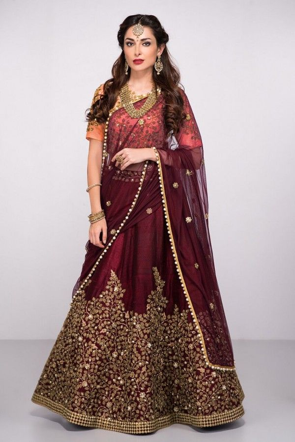 Drawing inspiration from floral intricate details,this Maroon Embroidered Bridal Lehenga is an impressive delight to watch in the big day. Falling into an A-line silhouette, The lehenga choli is adorned with shimmering Dori, Badla & Glitter Sequins work t