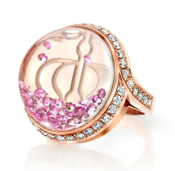 Luscious pink sapphires float inside the dome of this stunning 'Stars of Africa' ring! 18k rose gold, 1.50 carat pink sapphires inside the dome and 0.83 carat white diamonds pavé set outside.