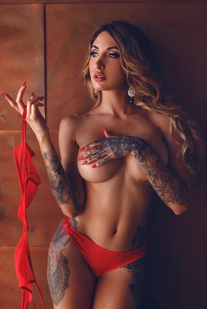 cute tattooed girl with big tits
