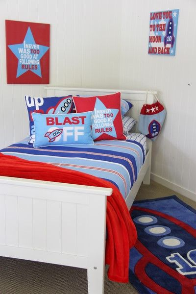 Fun theming with rocket rug, wall art & Patersonrose cushions, makes the Nautical boys room very magestic.