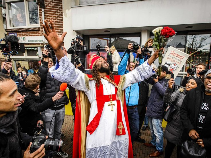 Dutch actor Patrick Mathurin, center, and anti-racism demonstrators protest against the traditional figure Black Pete in Meppel, Netherlands. Black Pete, or Zwarte Piet, the companion of Saint Nicolas during the Sinterklaas Festival, has become the subject of much controversy in recent years as some people think it is racist. Remko De Waal, European Pressphoto Agency