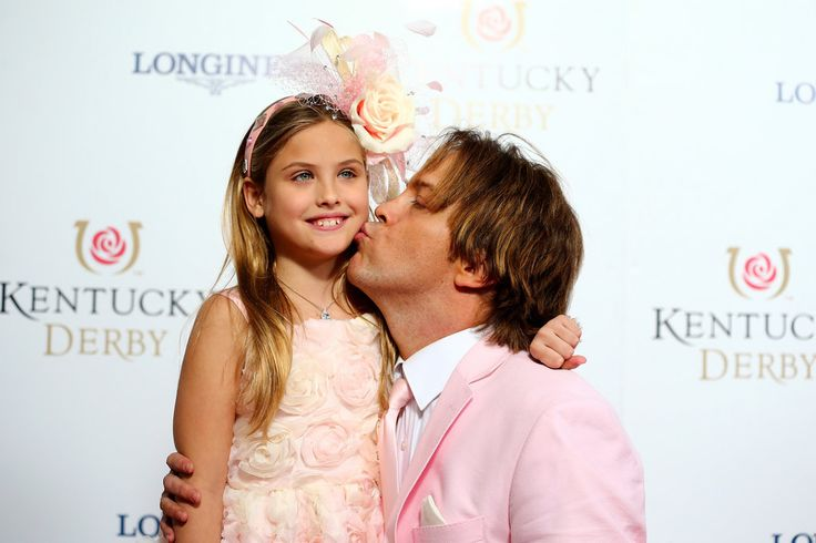 Dannielynn Birkhead looks more and more like her late mother with each year that passes. On Saturday, Anna Nicole Smith's daughter made a rare public appearance at the Kentucky Derby in Louisville, KY. The 8-year-old walked the red carpet with her doting dad, Larry Birkhead, who kneeled down to give her a sweet kiss. The duo dressed to impress in matching pink outfits! Dannielynn couldn't have looked happier, showing off her floral dress and headpiece with a big smile. 2 May, 2015